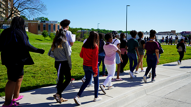 Image of a group of students walking together.