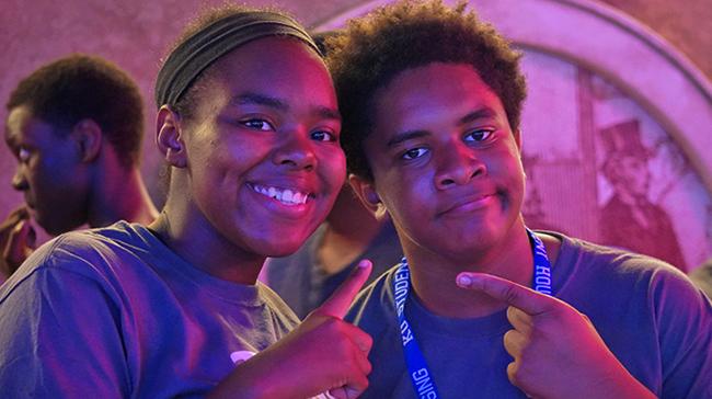 Image of African American boy and girl having fun.