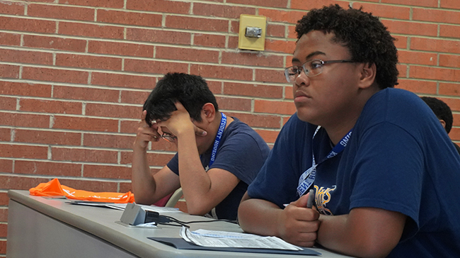 Image of students listening.